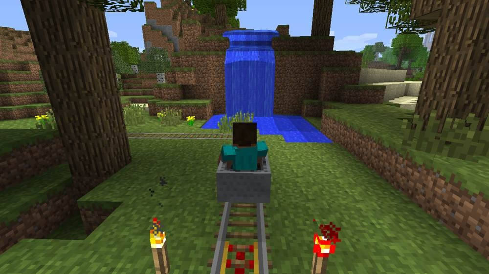 Minecraft for Xbox 360- Steve Riding in a Minecart