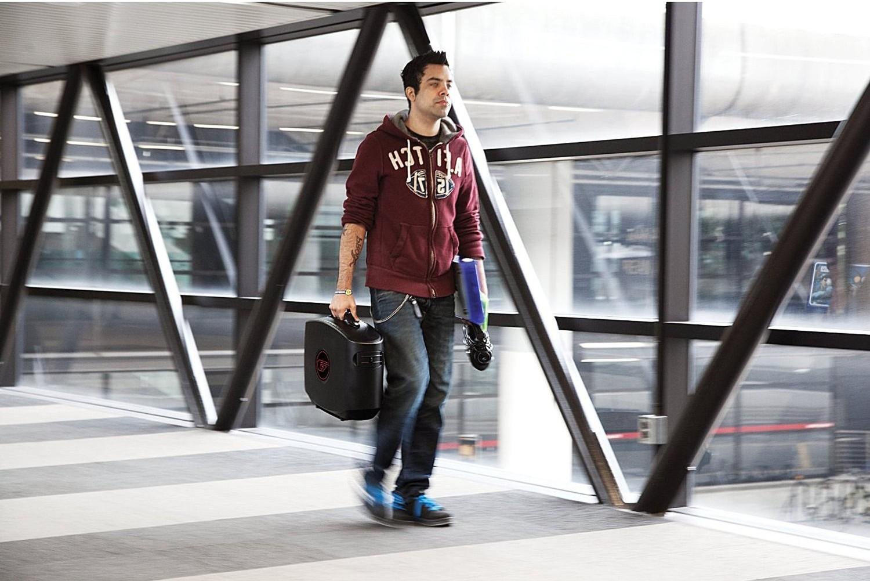 Guy Walking With GAEMS G155 Portable Gaming Case