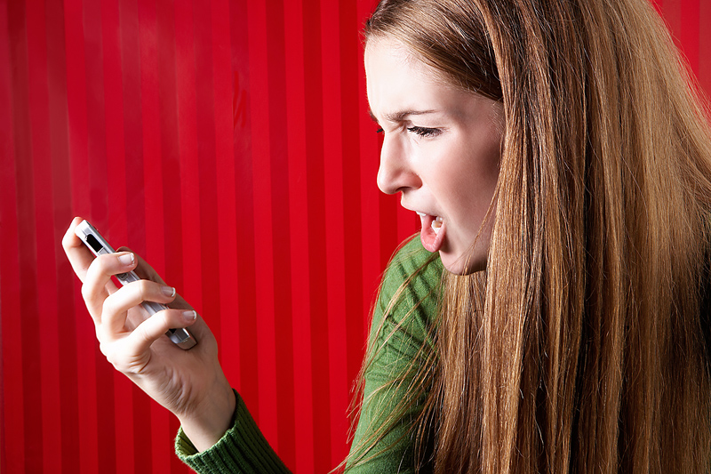 Girl Angry at her Smartphone - Pure Emotion