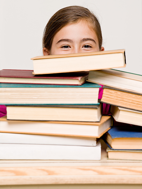 Girl with Stack of Textbooks
